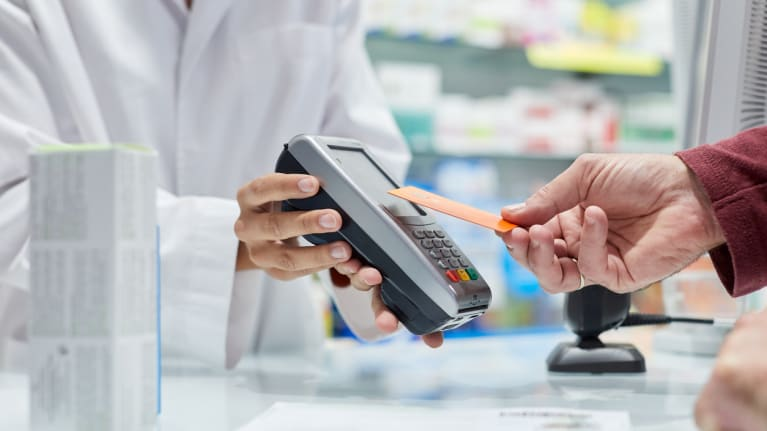 customer paying for prescription at pharmacy