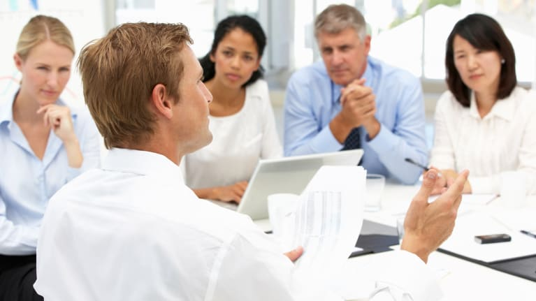 meeting of five business professionals