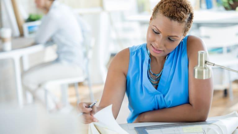 businesswoman reviewing plans