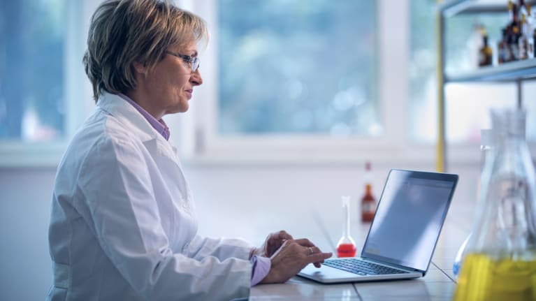 clinical pharmacist working on laptop