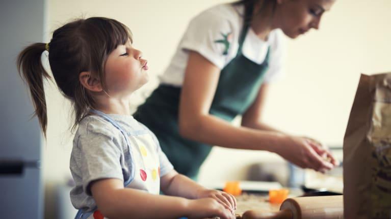 little girl baking cookies