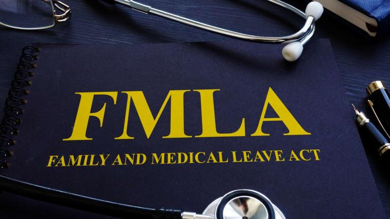 FMLA handbook with stethoscope