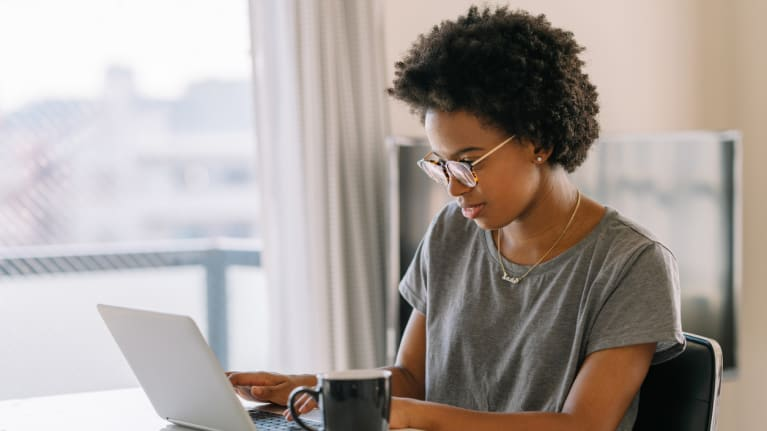telecommuting woman at her laptop