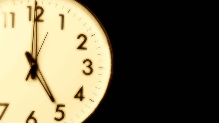 Clock face with the time of 5 o'clock