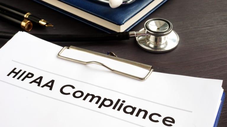 HIPAA compliance documents and a stethoscope