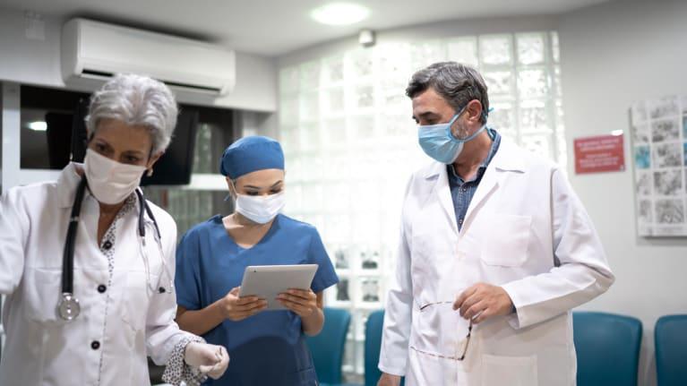 hospital employees wearing masks