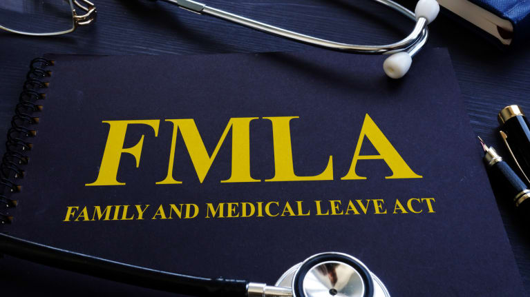 a stethoscope on an FMLA manual
