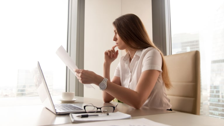 Businesswoman reviewing a contract