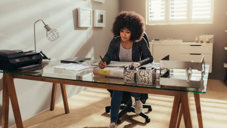 telecommuter working at her desk