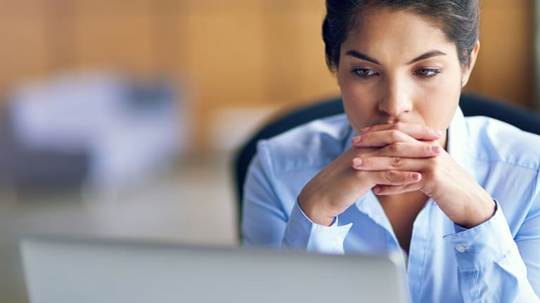 business woman concentrating on information on laptop