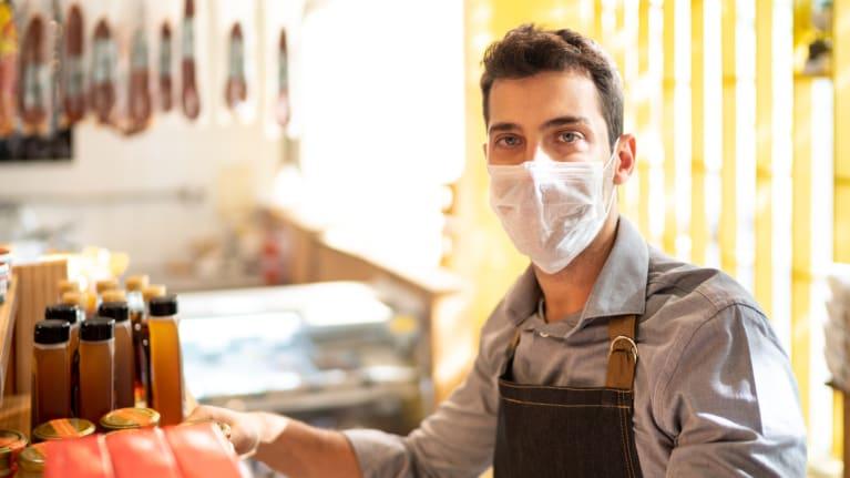 Shop employee wearing mask