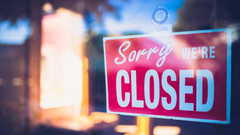 Sign on a business door saying sorry we're closed