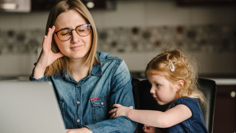 telecommuting mother with daughter