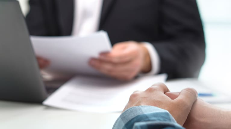 business person reviewing paperwork