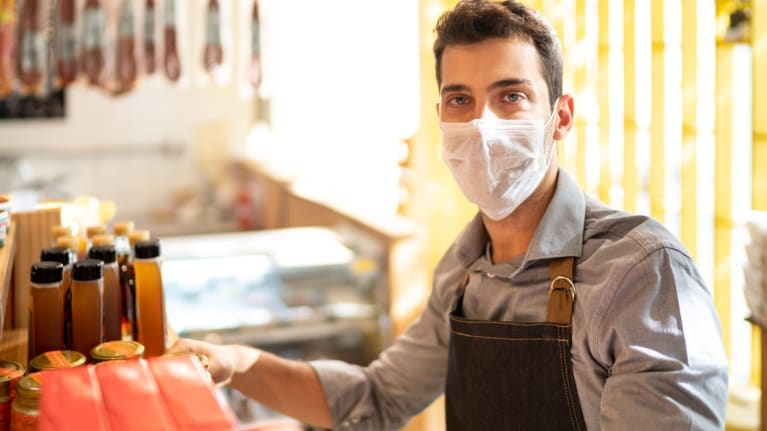 man wearing mask working in store