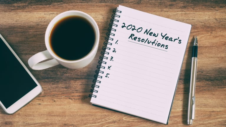 smart phone, coffee cup, notebook with 2020 resolutions list