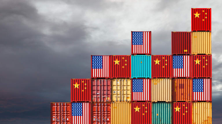 Alternating U.S. and Chinese flags on the sides of cargo shipping containers