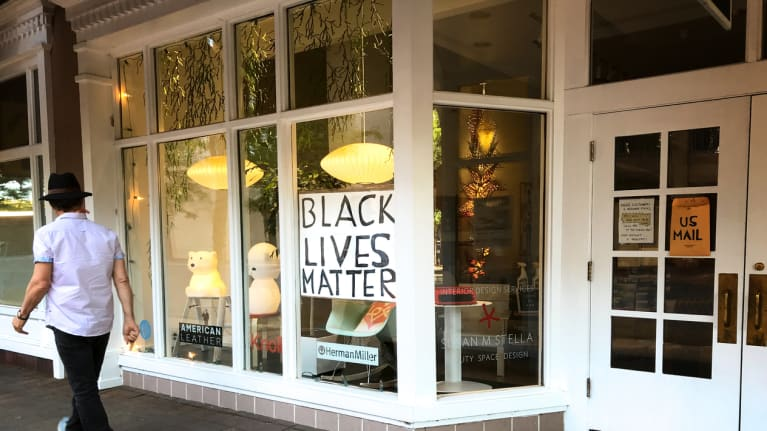 Black Lives Matter sign in store window