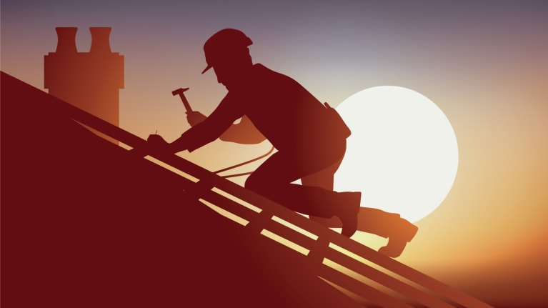 a construction worker working on a roof beneath the sun