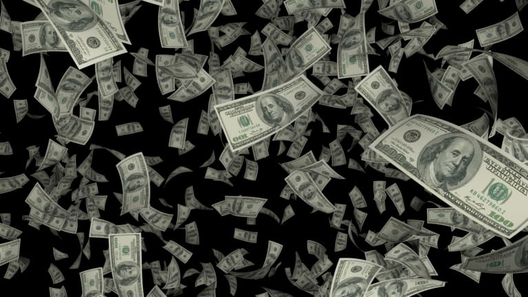Hundred dollar bills falling all around