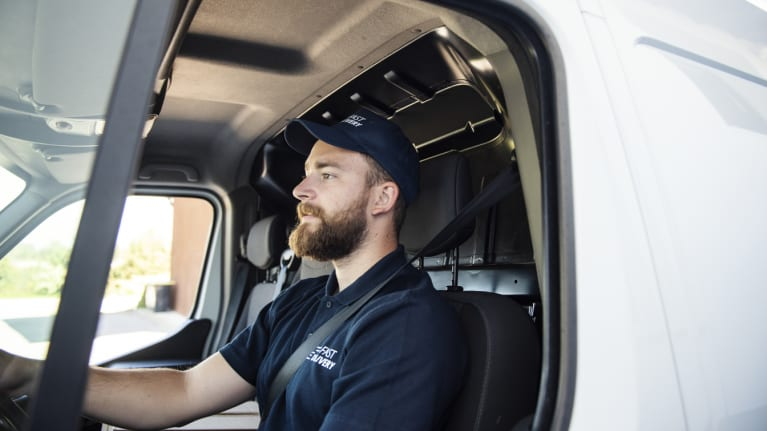 man sitting in a delivery truck