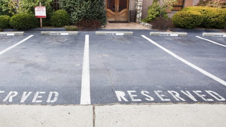 End Reserved Employee Parking by March 31 or Owe 2018 Taxes