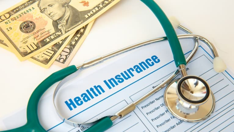 Health Plan Premium Surcharges for the Unvaccinated?