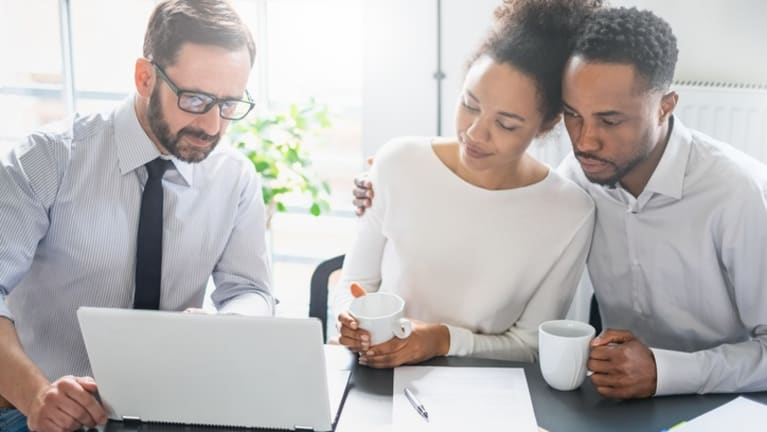 investment advisor making recommendations to couple
