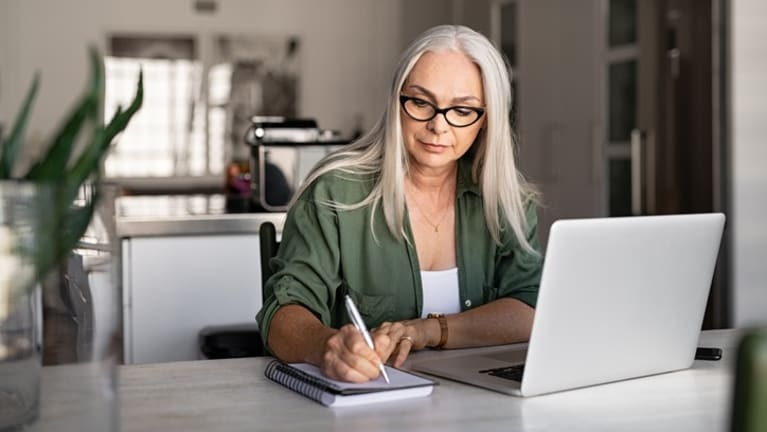 Woman researching investment funds online.