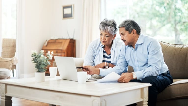 Older couple reviewing financial statements.