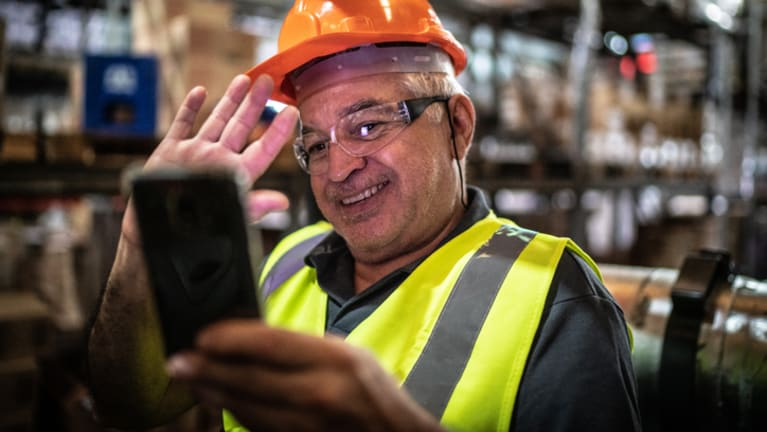 warehouse worker on phone