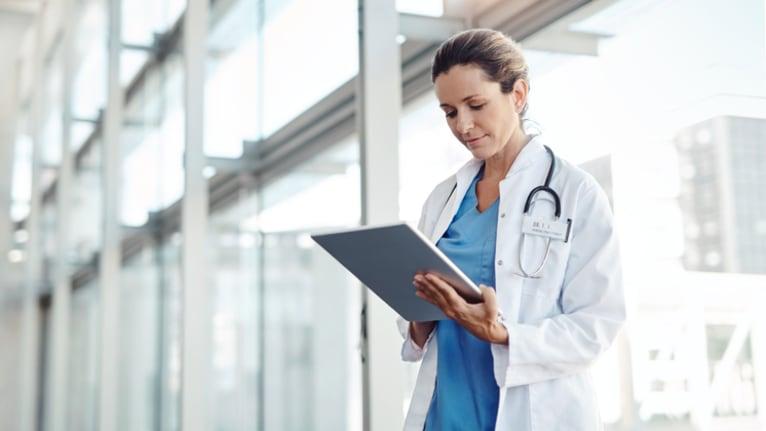 nurse on digital tablet