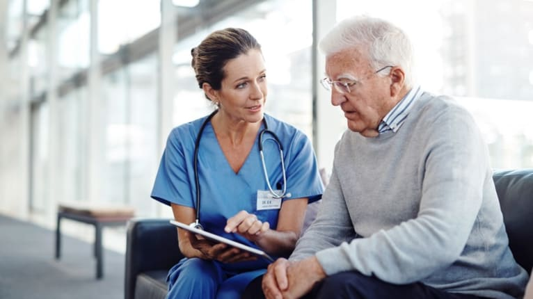 older patient and doctor
