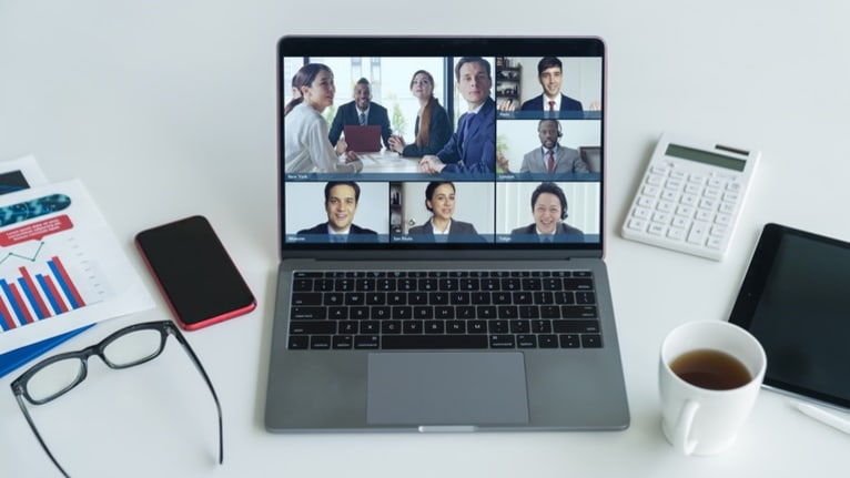 laptop screen of multiple remote workers meeting together
