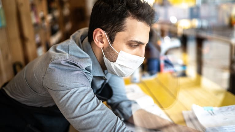 a worker with a face mask on