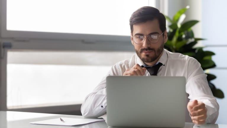 man reading online document
