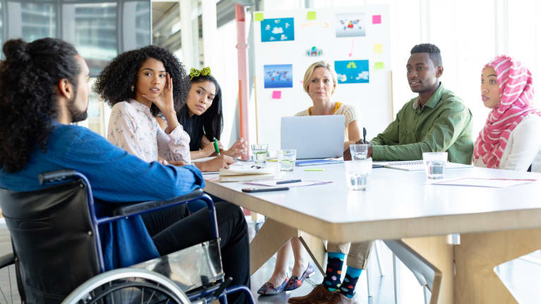 DIverse co-workers, including a wheelchair user