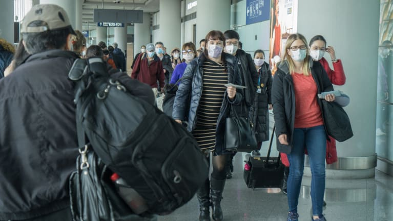 people wear  masks to prevent spread of disease