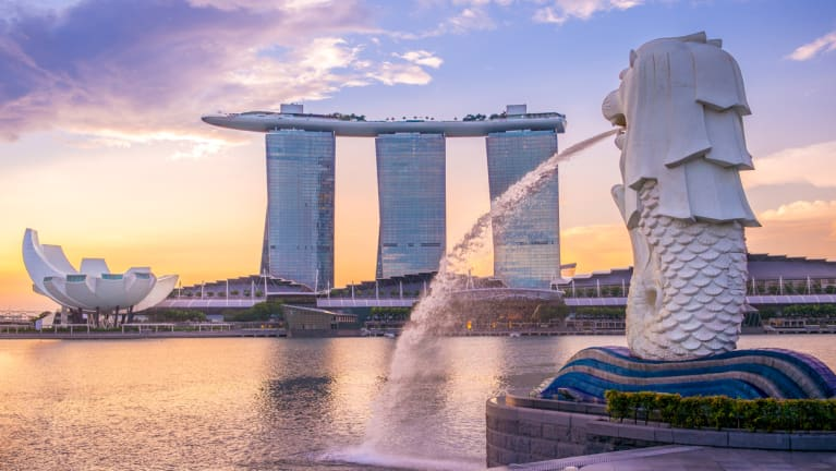 modern Singapore building in background with water fountain in foreground